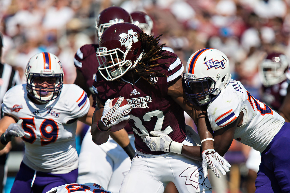 STARKVILLE, MS - SEPTEMBER 19:  Ashton Shumpert #32 of the Mississippi State Bulldogs and is tackled by Darius Poullard #26 of the Northwestern State Demons at Davis Wade Stadium on September 19, 2015 in Starkville, Mississippi.  The Bulldogs defeated the Demons 62-13.  (Photo by Wesley Hitt/Getty Images) *** Local Caption *** Ashton Shumpert; Darius Poullard