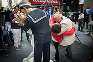 In New York City's Times Square on August 14, 2014, on the 69th anniversary of the end of the war, WWII vet Sydnor Thompson, 90, reenacted the famous kiss with his wife, Harriette, 91, both of Charlotte, NC, in front of the just unveiled sculpture of the kiss. Afterwards, others joined in the act.