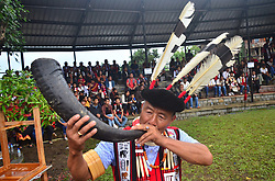 May 1, 2019 - Chuchuyimlang, Nagaland, India - An Ao Naga man blow a Buffalo horn at the Moatsü festival, post seed sowing festival at Chuchuyimlang, under Mokokchung district of India north eastern state of Nagaland on Wednesday, 01 May 2019. Moatsü, the premier festival of the Ao Nagas, is celebrated every year in the month of May after the sowing season to please the Gods of Nature and invoke their blessing for a bumper harvest. (Credit Image: © Caisii Mao/NurPhoto via ZUMA Press)