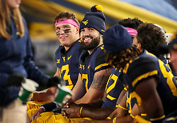Oct 25, 2018; Morgantown, WV, USA; West Virginia Mountaineers quarterback Will Grier (7) smiles along the bench during the fourth quarter against the Baylor Bears at Mountaineer Field at Milan Puskar Stadium. Mandatory Credit: Ben Queen-USA TODAY Sports