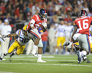 Ole Miss' Brandon Bolden (34) is chased by LSU's Derrick Bryant (36) and Brandon Taylor (18) at Vaught-Hemingway Stadium in Oxford, Miss. on Saturday, November 19, 2011. LSU won 52-3.