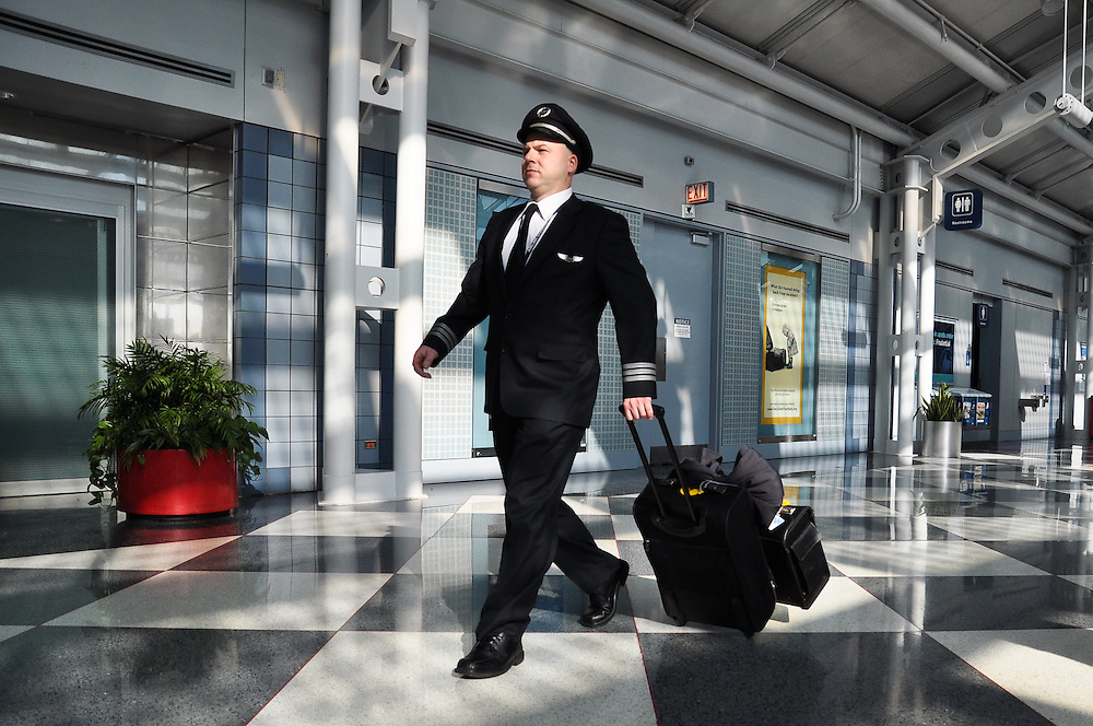 An airline pilot strides through the terminal at O'Hare International Airport, Chicago, 2011