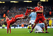 Steven Gerrard collides with team mate Ryan Babel during the Barclays Premier League match between Liverpool and Manchester City at Anfield - 21/11/09
