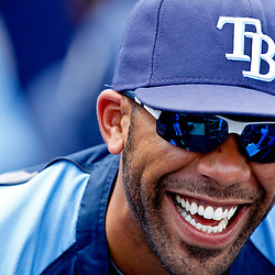 March 21, 2012; Port Charlotte, FL, USA; Tampa Bay Rays starting pitcher David Price (14) laughs with teammates in the dugout during a spring training game against the New York Yankees at Charlotte Sports Park.  Mandatory Credit: Derick E. Hingle-US PRESSWIRE
