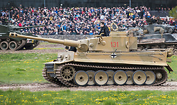 © Licensed to London News Pictures. 28/04/2018. Dorset, UK. German WWII battle tank legend 'Tiger 131' is driven round the arena at Bovington Tank Museum on the 75th anniversary of it's capture. Tiger 131, the only running Tiger I in the world was the first example of the fearsome new German fighting machine to be captured by the allies when it was captured during fierce fighting in the Tunisian desert in 1943. Photo credit: Peter Macdiarmid/LNP