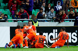 Players of Netherlands celebrate after they scored during the UEFA European Under-17 Championship Final match between Germany and Netherlands on May 16, 2012 in SRC Stozice, Ljubljana, Slovenia. Netherlands defeated Germany after penalty shots and became European Under-17 Champion 2012. (Photo by Vid Ponikvar / Sportida.com)
