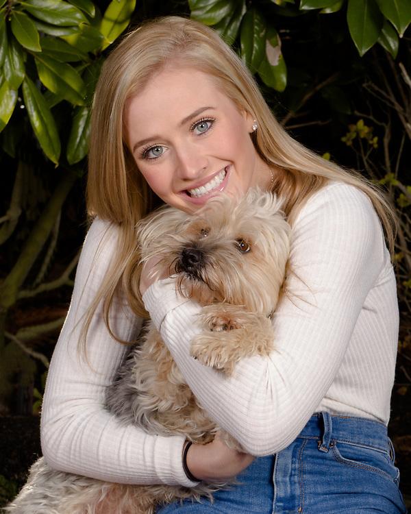 Portrait of model/actress Savannah O'Hara hugging her pet dog.