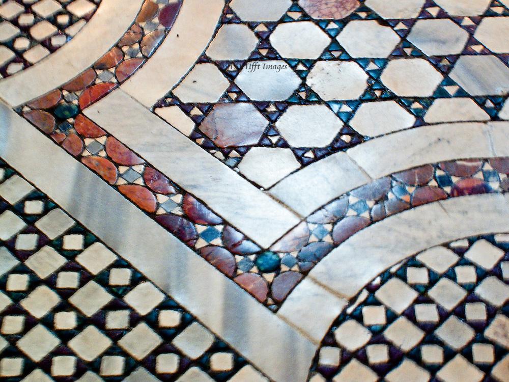 Santa Pudenziana, nave; Cosmati floor, close up showing pattern and shapes.
