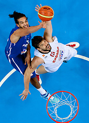 Joakim Noah of France vs Marc Gasol of Spain during final basketball game between National basketball teams of Spain and France at FIBA Europe Eurobasket Lithuania 2011, on September 18, 2011, in Arena Zalgirio, Kaunas, Lithuania. Spain defeated France 98-85 and became European Champion 2011, France placed second and Russia third. (Photo by Vid Ponikvar / Sportida)