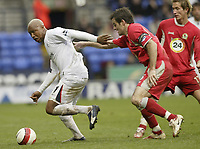 Photo: Aidan Ellis.<br /> Bolton Wanderers v Blackburn Rovers. The Barclays Premiership. 04/03/2007.<br /> Bolton's El Hadj Diouf (L) is watched closely by Blackburn's Ryan Nelsen