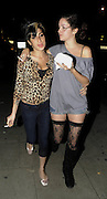 11.OCTOBER.2009 - LONDON<br /> <br /> POP DIVA AMY WINEHOUSE EATS OUT WITH FRIENDS AT COTTONS CARIBBEAN RESTAURANT IN CAMDEN. WHEN LEAVING IT SEEMS AMY HAD UNBUTTONED HER TOP TO SHOW OF HER NEW 35K CLEAVAGE.<br /> <br /> BYLINE: EDBIMAGEARCHIVE.COM<br /> <br /> *THIS IMAGE IS STRICTLY FOR UK NEWSPAPERS &amp; MAGAZINES ONLY*<br /> *FOR WORLDWIDE SALES &amp; WEB USE PLEASE CONTACT EDBIMAGEARCHIVE-0208 954 5968*