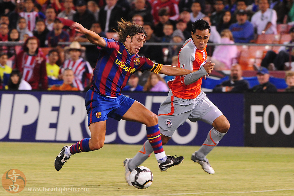 August 8, 2009; San Francisco, CA, USA; Chivas de Guadalajara forward Jesus Padilla (15, right) fights for the ball with FC Barcelona defender Carles Puyol (5, left) during the second half in the Night of Champions international friendly contest at Candlestick Park. The game ended in a 1-1 tie.