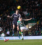 Dundee&rsquo;s Kane Hemmings oujumps Celtic's Mikael Lustig - Celtic v Dundee - Ladbrokes Scottish Premiership at Dens Park<br /> <br />  - &copy; David Young - www.davidyoungphoto.co.uk - email: davidyoungphoto@gmail.com