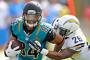 Jacksonville Jaguars wide receiver Cecil Shorts (84) is tackled by San Diego Chargers cornerback Johnny Patrick (26) during an NFL game at EverBank Field on Oct. 20, 2013 in Jacksonville, Florida. San Diego won 24-6.<br /> <br /> &copy;2013 Scott A. Miller