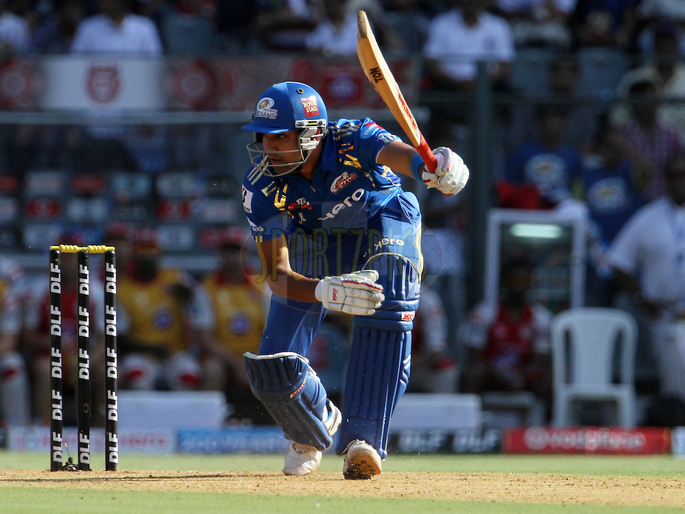Mumbai Indian player Rohit Sharma plays a shot during match 28 of the Indian Premier League ( IPL) 2012  between The Mumbai Indians and the Kings X1 Punjab held at the Wankhede Stadium in Mumbai on the 22nd April 2012..Photo by: Vipin Pawar/IPL/SPORTZPICS