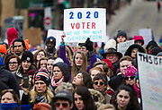 Zoe Thompson, center, a junior from Edgerton High School raises a sign during the March for our Lives protest in Madison, Wisconsin, Saturday, March 24, 2018.