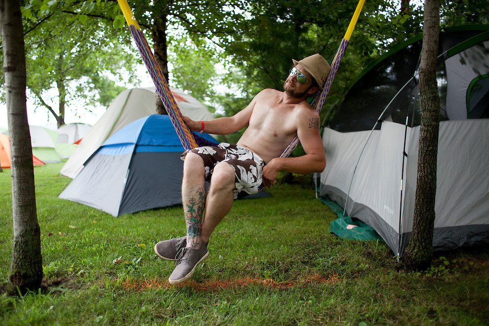 Bryan Avery of Cedar Rapids hangs out to watch people arriving at Camp Euforia on Thursday, July 16, 2015. The three-day music festival is held on Jerry Hotz's 120-acre farm north of Lone Tree in Johnson County.
