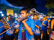 24 NOVEMBER 2015 - BANGKOK, THAILAND:  A high school marching band performs at the Wat Saket temple fair. Wat Saket is on a man-made hill in the historic section of Bangkok. The temple has golden spire that is 260 feet high which was the highest point in Bangkok for more than 100 years. The temple construction began in the 1800s in the reign of King Rama III and was completed in the reign of King Rama IV. The annual temple fair is held on the 12th lunar month, for nine days around the November full moon. During the fair a red cloth (reminiscent of a monk's robe) is placed around the Golden Mount while the temple grounds hosts Thai traditional theatre, food stalls and traditional shows.       PHOTO BY JACK KURTZ