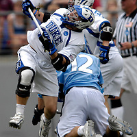 28 May 2007: Johns Hopkins midfielder Stephen Peyser (12) is hit by defenseman Tony McDevitt (l) after firing a shot on goal in the 3rd quarter while being defended by Duke University mid fielder Steve Schoeffel (r) in the NCAA Division I Lacrosse Championship game.  The Johns Hopkins Blue Jays defeated the Duke Blue Devils 12-11 to win the NCAA Division I Lacrosse championship at M&T Bank Stadium in Baltimore, Md. .