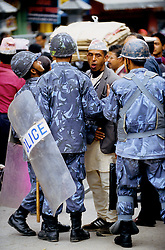 """Armed Police Forces blocking ordinary people from crossing the main road during the nation's Democracy Day. Authorities have once again cut off local telephone lines. """"Today we have arrested several people. They were planning pro-democracy rallies, but we didn't give them any chance to demonstrate"""", a police officer says."""