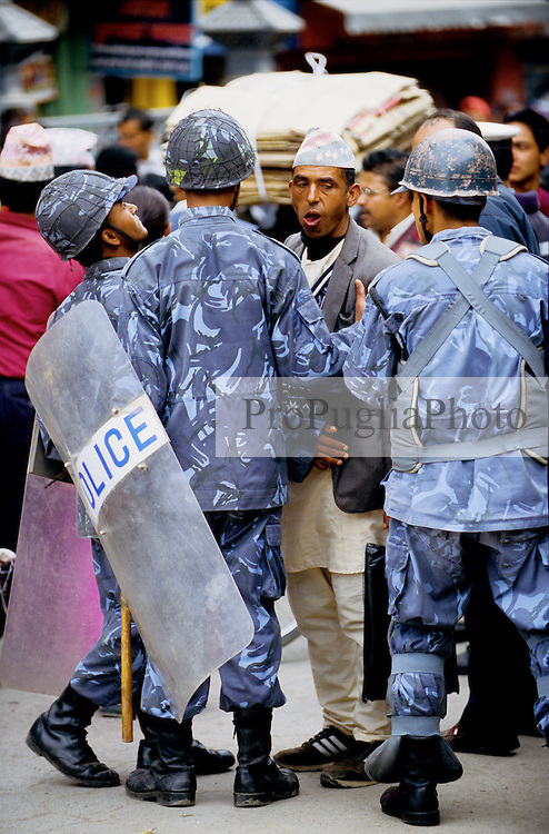 "Armed Police Forces blocking ordinary people from crossing the main road during the nation's Democracy Day. Authorities have once again cut off local telephone lines. ""Today we have arrested several people. They were planning pro-democracy rallies, but we didn't give them any chance to demonstrate"", a police officer says."