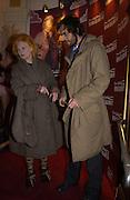 Andreas Kronthaler and Vivienne Westwood, M.A.C. Aids fund benefit concert given by Elton John. Shepherds Bush Empire. 16 December 2002.<br />© Copyright Photograph by Dafydd Jones 66 Stockwell Park Rd. London SW9 0DA Tel 020 7733 0108 www.dafjones.com
