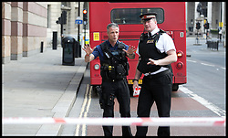 City of London Police seal of an area in Bank after what is thought to be a Suspicious Package in the Bank district of London, United Kingdom. Thursday, 15th May 2014. Picture by Daniel Leal-Olivas / i-Images