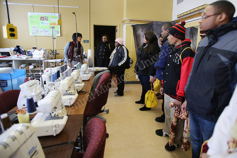 On Friday, February 20, 2015, students from Detroit International Academy and Detroit Collegiate Preparatory High School at Northwestern made tie-dyed scarves with the help of Apparel Merchandising and Design Professor Usha Chowdhary, Ph.D in Wightman Hall as part of their campus tour. They also toured the sewing lab and Engineering and Technology Building.<br /> <br /> Photo Intern: Katy Kildee