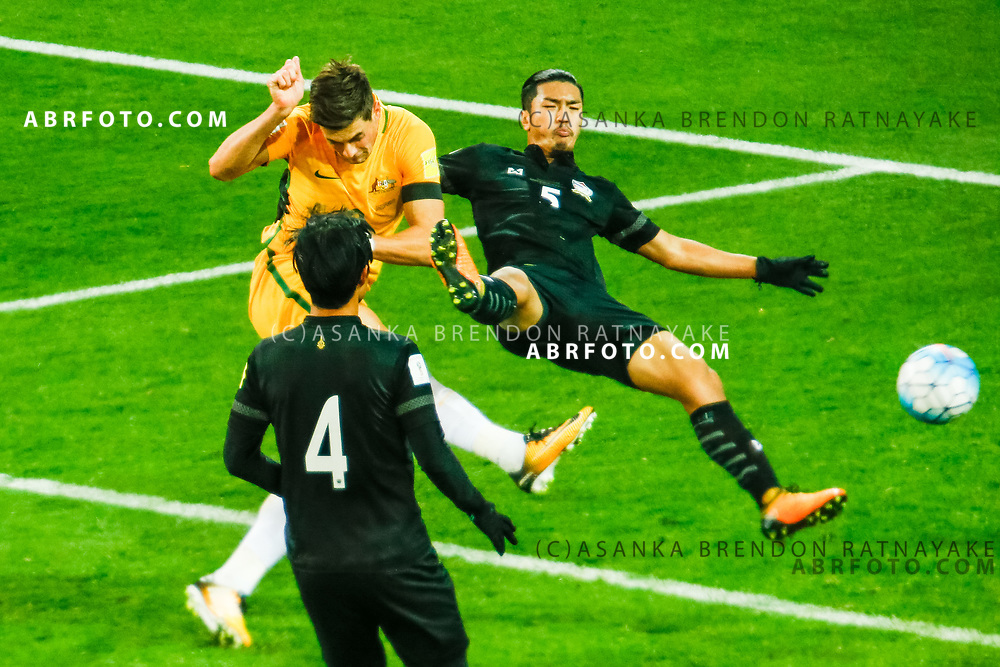 MELBOURNE, AUSTRALIA - SEPTEMBER 5 :  Tomi Juric of the Australia Socceroos has a shot on goal as Adisorn Promrak of Thailand attempts to stop it in mid air during the Stage 3 Group World Cup Football Qualifiers between Australia Vs Thailand at the Melbourne Rectangular Stadium, Melbourne, Australia 5 September 2017.