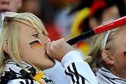 A young German fan blows a Vuvuzela during the 2010 FIFA World Cup South Africa Group D match between Ghana and Germany at Soccer City Stadium on June 23, 2010 in Johannesburg, South Africa.