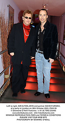 Left to right, SIR ELTON JOHN and partner DAVID FURNISH,  at a party in London on 28th October 2003.PNW 99