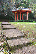 A red gazebo in a garden at the Byodo-In Japanese Temple on Oahu.