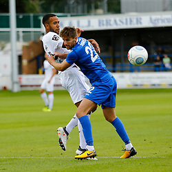Eastleighs midfielder Joe Jones manhandles Dovers defender Kevin Lokko during the National League match between Dover Athletic FC and Eastleigh FC at Crabble Stadium, Kent on 25 August 2018. Photo by Matt Bristow.