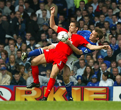 LIVERPOOL, ENGLAND - Saturday, April 19, 2003: Everton's Alan Stubbs gets hold of Liverpool's Milan Baros by the neck during the Merseyside Derby Premiership match at Goodison Park. (Pic by David Rawcliffe/Propaganda)