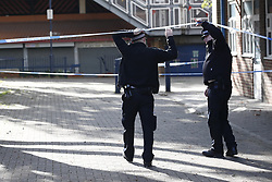 © Licensed to London News Pictures. 18/10/2018. London, UK. Police enter a cordon on the Doddington estate in Battersea after a man in his 40's died after an alleged assault. Police were called at around 5. 30pm to reports of several males fighting. Photo credit: Peter Macdiarmid/LNP
