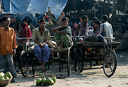 BANGLADESH DHAKA KAWRAN BAZAAR 2MARB05 - Van pullers relax after a morning's work at Kawran Bazaar vegetable market. The Bazaar has been in the Tejgaon area for at least 30 years and is one of the largest markets in Dhaka city...jre/Photo by Jiri Rezac..© Jiri Rezac 2005..Contact: +44 (0) 7050 110 417.Mobile:  +44 (0) 7801 337 683.Office:  +44 (0) 20 8968 9635..Email:   jiri@jirirezac.com.Web:    www.jirirezac.com..© All images Jiri Rezac 2005- All rights reserved.