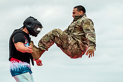 "A Soldier demonstrates hand-to-hand combat on a ""volunteer"" from the crowd during the 6th Ranger Training Battalion's open house event April 29 at Eglin Air Force Base, Fla. The event was a chance for the public to learn how Rangers train and operate. The event displays showed equipment, weapons, a reptile zoo, face painting and weapon firing among others. The demonstrations showed off hand-to-hand combat, a parachute jump, snake show, and Rangers in action. (U.S. Air Force photo/Samuel King Jr.)"