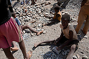 Kipushi, DRC. March 2009. Girls are particularly vulnerable because of the perceived earnings capacity boys carry in the society. In the DRC education has to be privately paid for, so as a consequence, girls are expected to contribute to the family income.