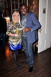 VANESSA FELTZ and BEN OFOEDU at a party to celebrate the publication of her new book - Kelly Hoppen: Ideas, held at Beach Blanket Babylon, 45 Ledbury Road, London W11 on 4th April 2011.