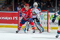 KELOWNA, CANADA - MARCH 13: Roman Basran #30 of the Kelowna Rockets defends the net behind Ethan McIndoe #10 of the Spokane Chiefs on March 13, 2019 at Prospera Place in Kelowna, British Columbia, Canada.  (Photo by Marissa Baecker/Shoot the Breeze)