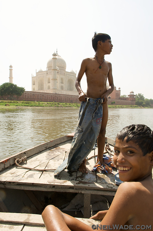 Some boy smiling after a swim in the river behind The Taj Mahal.  Agra, India.