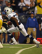 IRVING, TX - NOVEMBER 29: Wide receiver Terrell Owens #81 of the Dallas Cowboys runs for extra yardage after catching a pass during the game against the Green Bay Packers on November 29, 2007 at Texas Stadium in Irving, Texas. The Cowboys defeated the Packers 37-27. ©Paul Anthony Spinelli *** Local Caption *** Terrell Owens