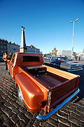 During summer from June to Septemper, every first Friday of the month is Vintage Car Cruising Night. Hundreds of classic American cars cruise around downtown Helsinki and meet at special places to have a good time, here at Kauppatori (Market Square), Uspenski orthodox cathedral in background. Cowboys and a more recent low rider Chevy truck.