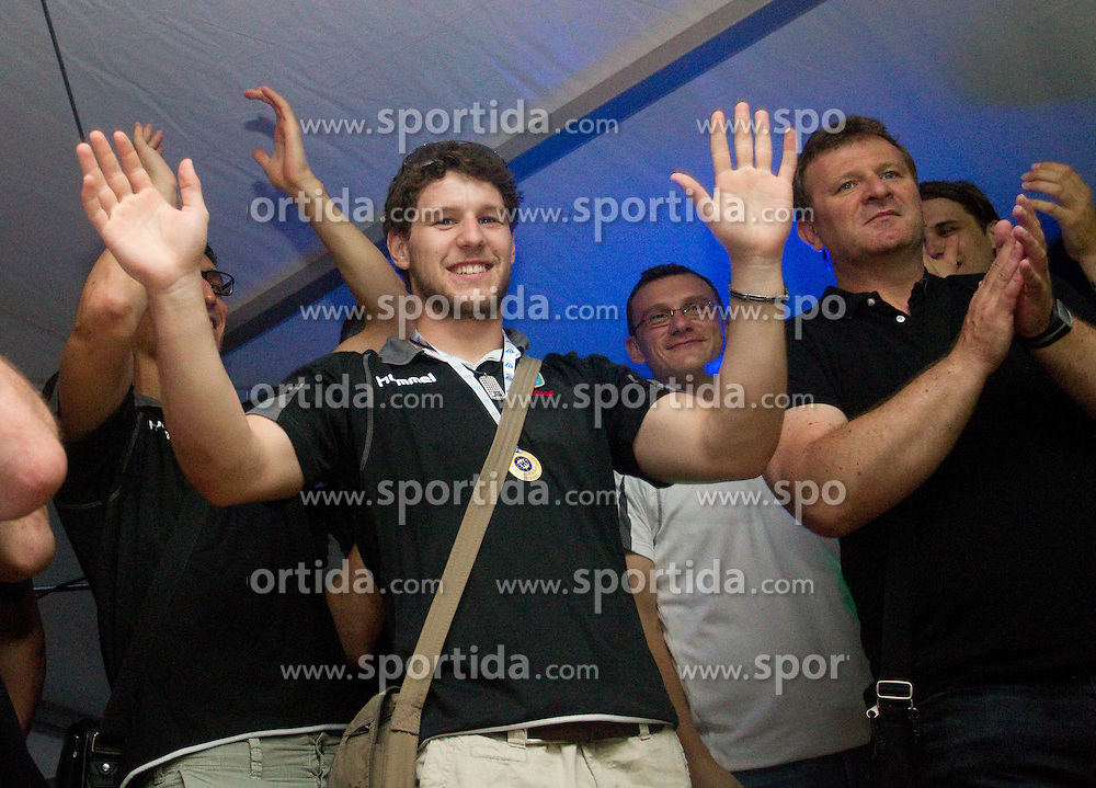 Ziga Smolnik, Fredi Radojkovic, head coach of Cimos Koper and fans celebrate  after the handball match between RK Cimos Koper (SLO) and SL Benfica (POR) in return final match of EHF Challenge Cup, on May 22, 2011 in Tent at Arena Bonifika, Koper, Slovenia. Koper defeated Benfica 31-27 and became Euro Challenge Champion 2011. (Photo By Vid Ponikvar / Sportida.com)