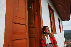 A woman sits outside of her home in Salento, a small town in the heart of Colombian coffee country. The tourism industry is slowly emerging in Quindio, the Colombian coffee country.  Old coffee haciendas have been turned into new hotels catering to tourists.  The countryside, some of the most beautiful in the country, is a popular weekend getaway spot where visitors can participate in a variety of outdoor activities as well as learn about coffee production.