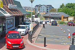 ©Licensed to London News Pictures 20/05/2020  <br /> Sittingbourne, UK. Queues of customers in their cars waiting to collect food at Sittingbourne McDonalds in Kent. McDonalds reopens drive thru lanes this morning at Forty restaurants across the UK as the fast food giant comes out of Coronavirus lockdown. Photo credit:Grant Falvey/LNP