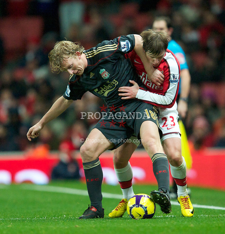 LONDON, ENGLAND - Wednesday, February 10, 2010: Liverpool's Dirk Kuyt and Arsenal's Andrei Arshavin during the Premiership match at the Emirates Stadium. (Photo by David Rawcliffe/Propaganda)