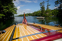 "Steve and Diane Clark take a cruise around Cow Island on Lake Winnipesaukee in their 19' 1949 Century ""Maiden '49"".  ©2018 Karen Bobotas Photographer"