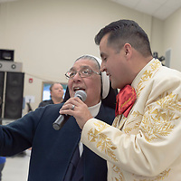 Mother Magda dings a duet with Mariachi singing Antonio Reyna at the blessing ceremony for the new San Damiano Hall in Gallup Friday.