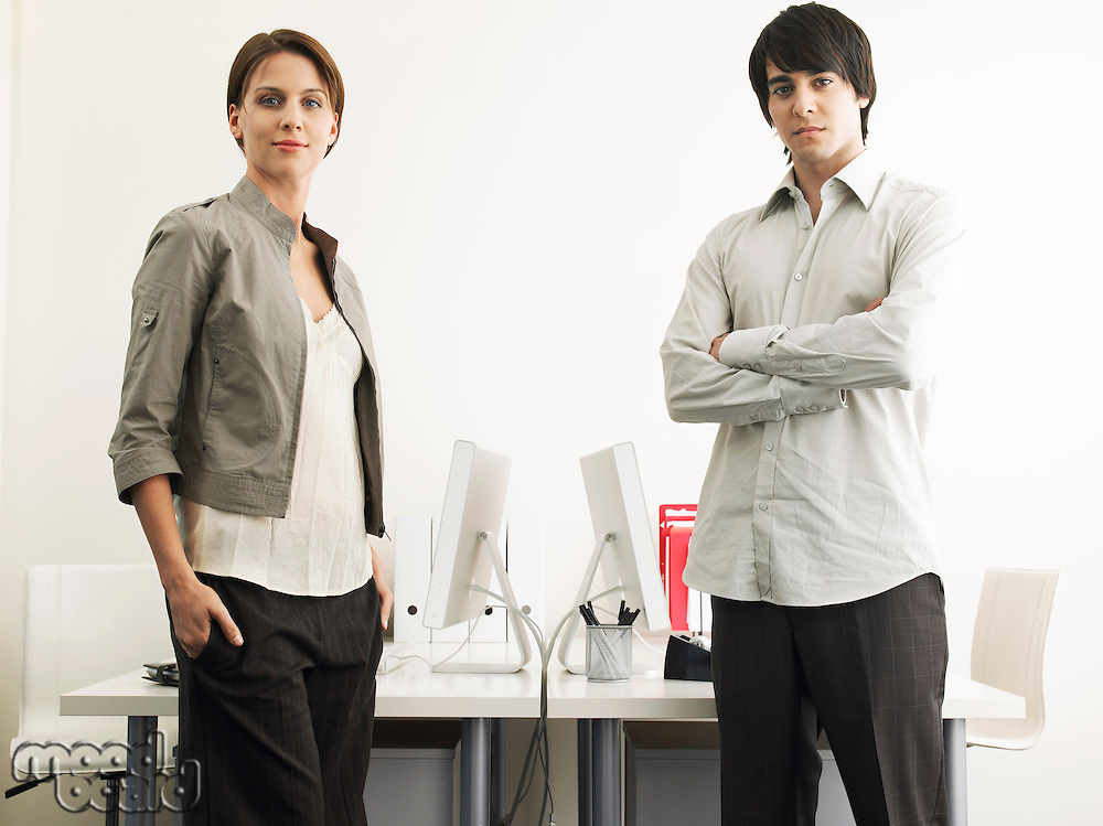 Business Man and Woman standing in office